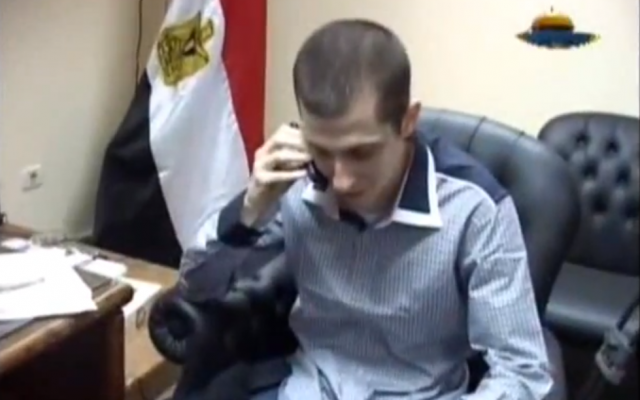 Gilad Shalit speaking on the phone moments before his return to Israel in 2011. (photo credit: image capture from video uploaded to YouTube by galberger)