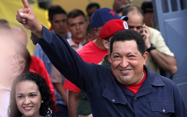 Venezuela's President Hugo Chavez leaves a polling station in Caracas after voting in presidential elections, October 8, 2012 (photo credit: AP/Rodrigo Abd)