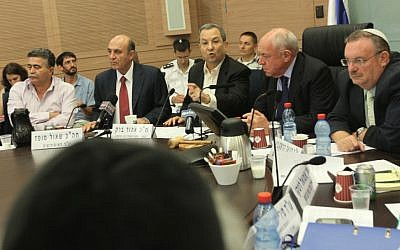 Defense Minister Ehud Barak sparring with the members of the Knesset Foreign Affairs and Defense Committee on Monday (photo credit: Miriam Alster/ Flash90)