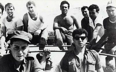 Benjamin Netanyahu, back row, third from left, in tank top, with his platoon mates on a command car (Photo credit: Courtesy: Avi Feder/ reproduction prohibited