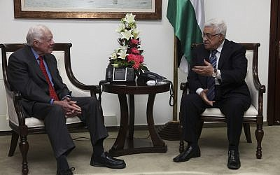 Jimmy Carter, left, with PA President Mahmoud Abbas in Ramallah (photo credit: Mati Milstein/The Elders)