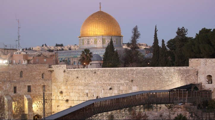 A view of a wooden footbridge leading up from the Western Wall to the Temple Mount compound in Jerusalem's Old City, with the Dome of the Rock in the background, December, 2011. (photo credit: Nati Shohat/Flash90)