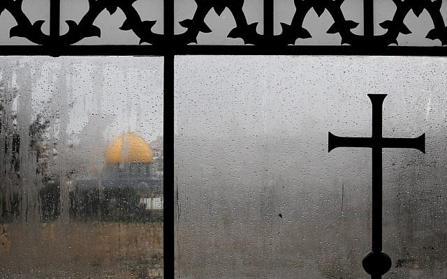 View of the Dome of the Rock, as seen from a window of the Dominus Flevit church in the Old City of Jerusalem (photo credit: Nati Shohat/Flash90)