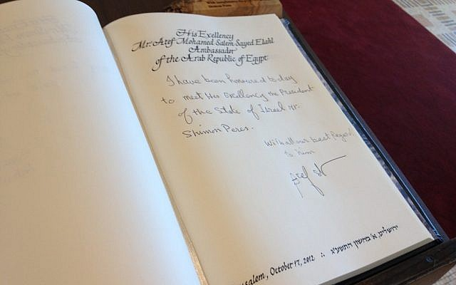 Ambassador Atef's entry in President Peres' guestbook (photo credit: Raphael Ahren/Times of Israel)