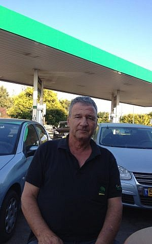 Doron Salzberg at the gas station he manages near Kibbutz Einat (Photo credit: Mitch Ginsburg/ Times of Israel)