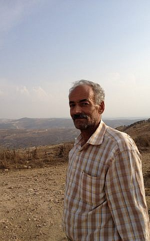 Ibrahim Salah, a resident of Farata, has been working in construction in Israel this year ever since his olive grove was vandalized (Photo credit: Mitch Ginsburg/ Flash 90)