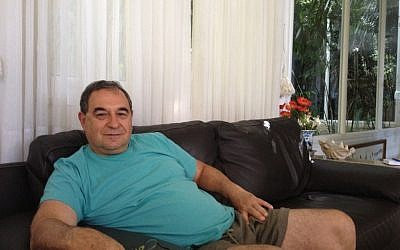 Amos Danieli in his home in Karmei Yosef (Photo credit: Mitch Ginsburg/ Times of Israel)