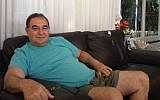 Amos Danieli in his home in Karmei Yosef (Mitch Ginsburg/Times of Israel)