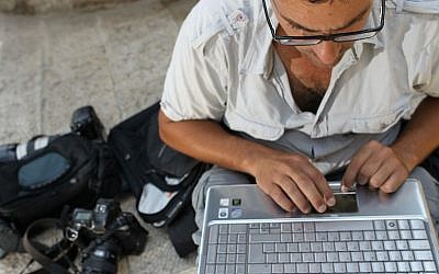 Man uses a laptop (Photo credit: Nati Shohat/Flash90)