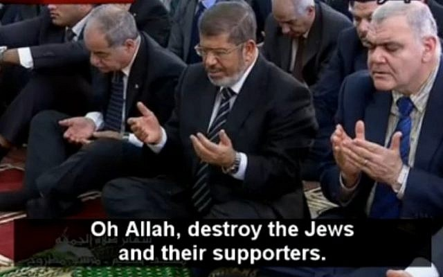 President Mohammed Morsi at prayer on October 19 at el-Taneim Mosque in Matrouh governorate (photo credit: MEMRI screenshot)