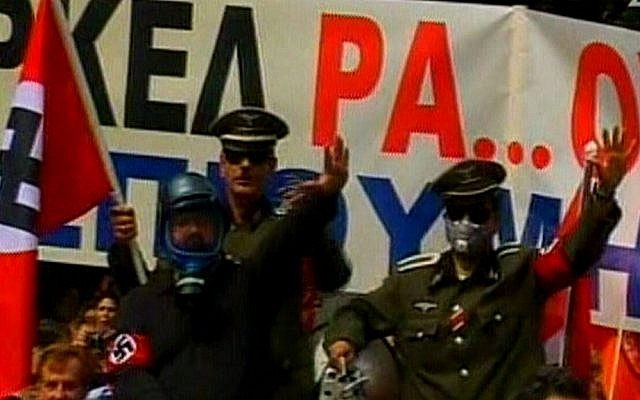 Protesters in Athens dress up as Nazi officers to greet German Chancellor Angela Merkel. (photo credit: image capture from Channel 2)