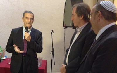 Serge Haroche, left, speaks in Tel Aviv as Minister Daniel Hershkowitz, right, and French ambassador Christophe Bigot look on, October 28, 2012 (photo credit: Raphael Ahren/Times of Israel)