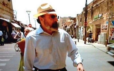 Mandy Patinkin striding in the streets of Jaffa (Screen shot/Times of Israel)