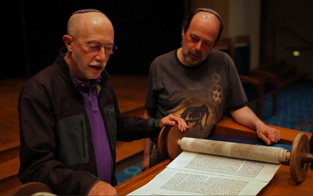 "A rabbi (Lawrence Kushner, left) introduces a pornographer (Matthew Jacobs) to the Torah in ""Your Good Friend."" (Photo credit: Courtesy of Dovetale Films)"