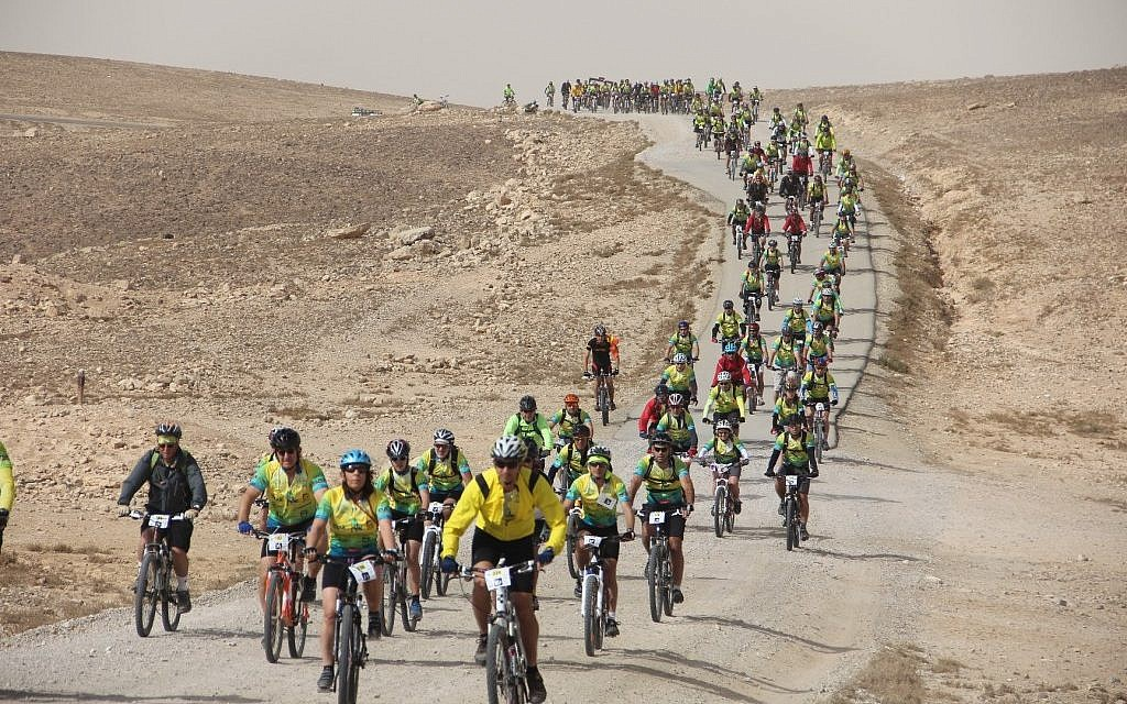 The 2012 Wheels of Love participants ride through Israel's desert (photo credit: courtesy ALYN)
