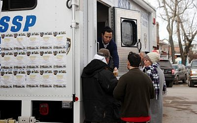 The Jewish volunteer patrol group Shomrim sets up a relief unit in Seagate this week with hot food, drinks and supplies. (Chavie Lieber/JTA)
