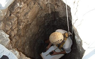 An Israel Antiquities Authority worker descends into a well discovered in the Jezreel Valley in 2012. (photo credit: Yotam Tepper, courtesy of the Israel Antiquities Authority)