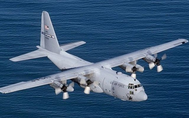 An illustrative photo of a Lockheed C-130E Hercules flying over the Atlantic Ocean (photo credit: US Air Force/Wikimedia Commons)