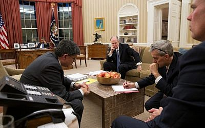 Barack Obama talks on the phone with Mohammed Morsi in the Oval Office while Chief of Staff Jack Lew, National Security Advisor Tom Donilon, and Deputy National Security Advisor Denis McDonough listen in last week. (photo credit: Pete Souza/Official White House Photo)