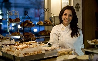 Keren Kadosh and her trays of home-baked goods (Courtesy Cafe Kadosh)