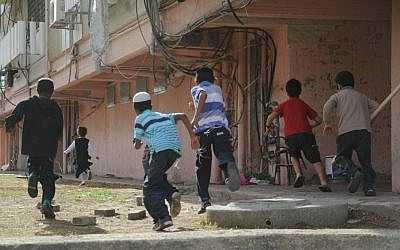 Children run toward a bomb shelter in the southern Israeli town of Kiryat Malachi during a November 2012 military operation in Gaza, known as Pillar of Defense. (Yuval Haker/Israel Defense Forces)