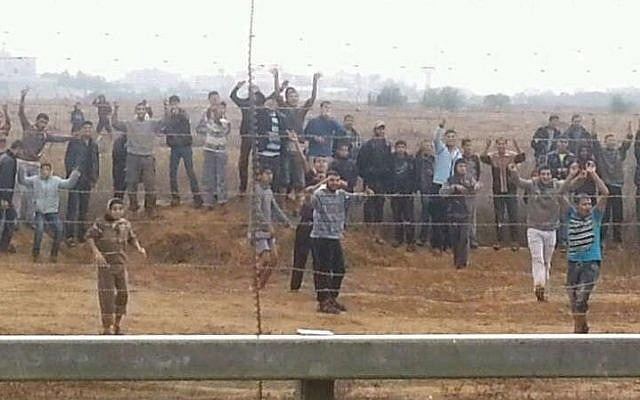 Palestinians in the Gaza Strip hurling rocks and attempting to breach the border fence in November 2012. (photo credit: IDF Spokesperson's Unit)