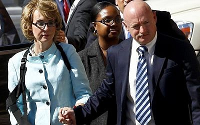 Former Democratic Rep. Gabrielle Giffords, left, and her husband, Mark Kelly (photo credit: AP/Ross D. Franklin)