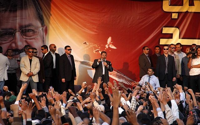 Egyptian President Mohammed Morsi speaks to supporters outside the Presidential palace in Cairo, Egypt, Friday, Nov. 23 (photo credit: AP/Aly Hazaza, El Shorouk)