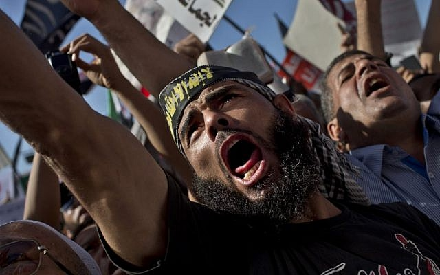 Egyptian Muslims shout Islamic slogans during a rally in Tahrir Square in Cairo in 2012. Thousands of ultraconservative Muslims rallied in the Egyptian capital, demanding the country's new constitution be based on the rulings of Islamic law, or Sharia. (AP Photo/Bernat Armangue)