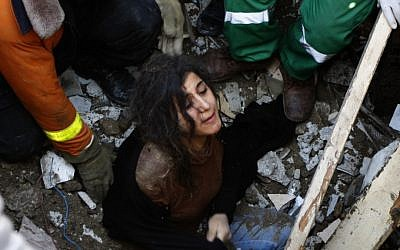 A member of the Abdel Aal family is rescued after his family house collapsed during an Israeli forces strike in the Tufah neighbourhood, Gaza City, Sunday, Nov. 18. (AP Photo/Majed Hamdan)