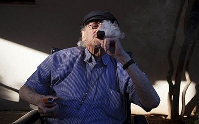 In this photograph taken on Tuesday, Oct. 30, 2012, Moshe Rute, 80, smokes medical cannabis at the old age home in Kibbutz Na'an, near the city of Rehovot, Israel. (AP Photo/Dan Balilty)