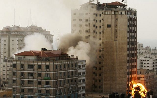 The Gaza media center being hit by an Israeli airstrike on Monday. (photo credit: AP/Hatem Moussa)