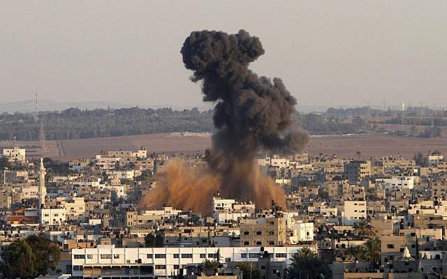 Smoke rises following an Israeli strike on Gaza City in 2012 (photo credit: AP/Hatem Moussa)