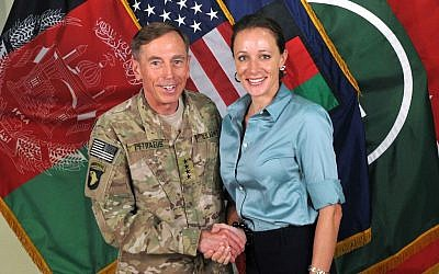 "This July 13, 2011, photo made available on the International Security Assistance Force's Flickr website shows the former Commander of International Security Assistance Force and US Forces-Afghanistan Gen. Davis Petraeus, left, shaking hands with Paula Broadwell, co-author of ""All In: The Education of General David Petraeus."" (AP Photo/ISAF)"