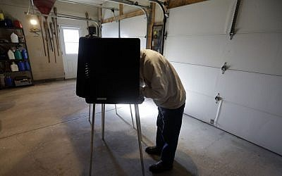 Bob Warhola casts his vote at a polling place inside a residential garage, Tuesday, Nov. 6, 2012, in Forest City, Pa. (Photo credit: Matt Slocum/AP)