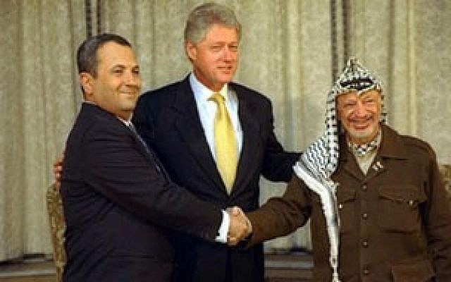 Ehud Barak, left, with Bill Clinton and Yasser Arafat (photo credit: Sharon Farmer)