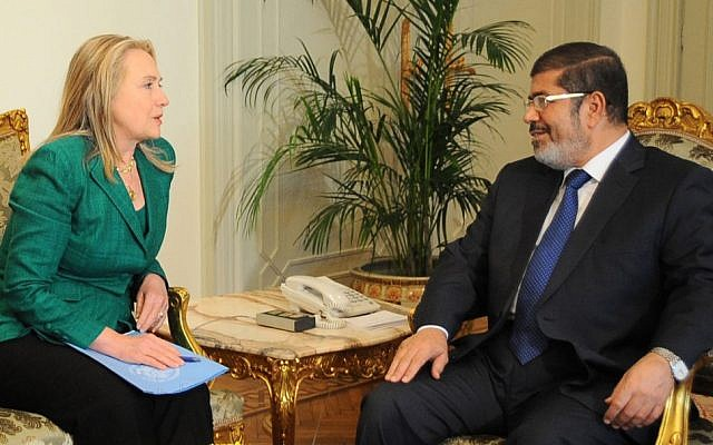 Then US Secretary of State Hillary Rodham Clinton meets with former Egyptian president Mohammed Morsi in Cairo, Egypt, Wednesday, November 21, 2012 (AP/Egyptian Presidency)