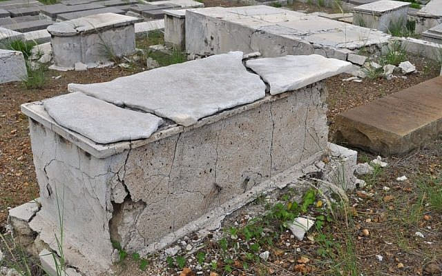 A crumbling tomb stands in the Beth Haim cemetery on the outskirts of Willemstad, Curacao (photo credit: AP/Karen Attiah)