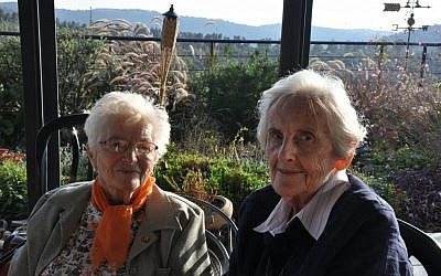 Anne Marie Steiner, 'Nemca,' and Judith Shaked sat outside last week. It was their first meeting in dozens of years. The two girls were best friends during their time in Denmark. (photo credit: Michal Shmulovich/ToI)