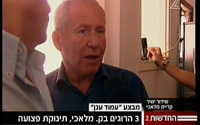 Home Front Defense Minister Avi Dichter visits the Kiryat Malachi apartment in which three people were killed on Thursday, November 15 (screen capture: Channel 2)