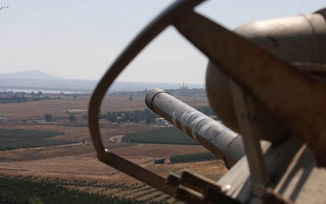 An Israeli tank overlooks the demilitarized zone from the Golan Heights (photo credit: Yossi Zamir/Flash90)