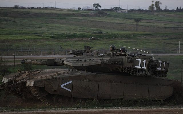 File photo of an IDF Merkava tank along the Israel-Gaza border fence (photo credit: Tsafrir Abayov/Flash90)