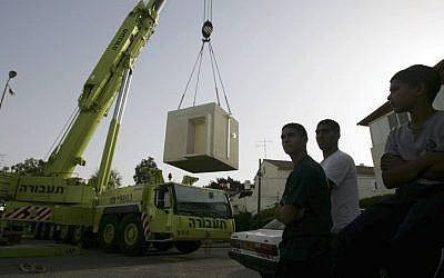 Workers place new bomb shelters in schools and day care centers in the southern Israeli town of Ashkelon. April, 2009. 20 more shelters were due to be installed on Sunday 18th November after increased Hamas rocket fire at the city. (photo credit: Edi Israel/Flash90)