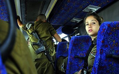 Soldiers sit on the bus on their way to an army base in Beersheba (photo credit: Serge Attal/Flash90/File)