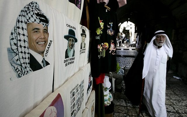 A T-shirt on sale in Jerusalem's old city depicts Obama donning traditional Arab headgear (photo credit: Abir Sultan/Flash 90)