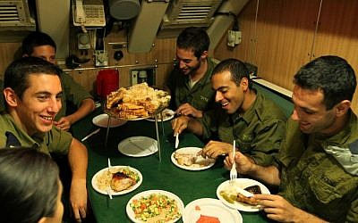 Israeli navy soldiers share a meal in the cramped quarters of the Dolphin-class submarine in Haifa (photo credit: Moshe Shai/Flash 90)