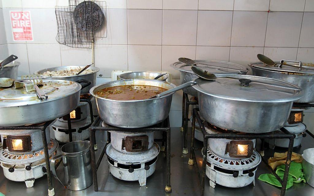 Cooking on kerosene at Azura (photo credit: Nati Shohat/Flash 90)