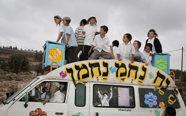 Too many children in a car (illustrative photo credit: Gershon Elinson/Flash90)