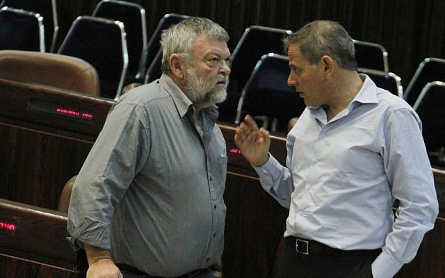 Meretz MK Ilan Gilon, left, speaks with fellow party member Nitzan Horowitz in the Knesset last November (photo credit: Miriam Alster/Flash90)