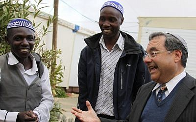 Rabbi Shlomo Riskin, right, welcomes students arriving from Uganda who will spend time at his Efrat yeshiva, January 3, 2012. Photo by Gershon Elinson/Flash90)
